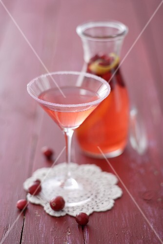 Cranberry liqueur in glass and carafe