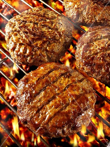 Burgers on barbecue rack