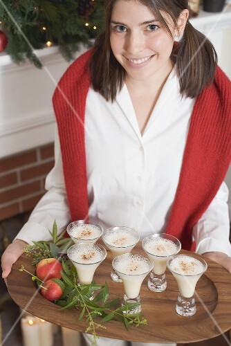 Young woman serving dessert (Christmas)