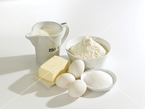 Various baking ingredients: butter, eggs, sugar, flour, milk