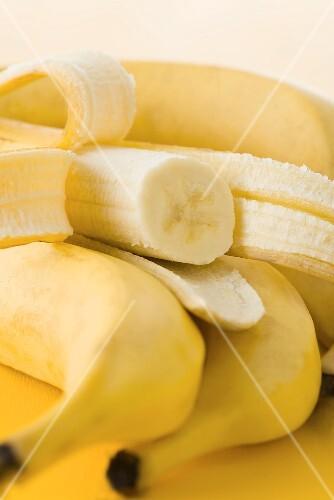 Fresh bananas, one half-peeled