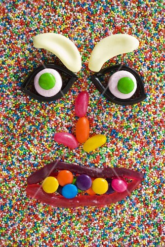 A face made from sweets on hundreds and thousands