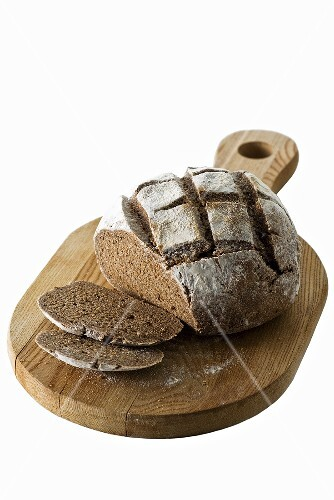 Dark rye bread, partly sliced