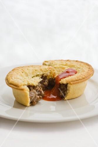 Meat pie with tomato sauce (Australia)