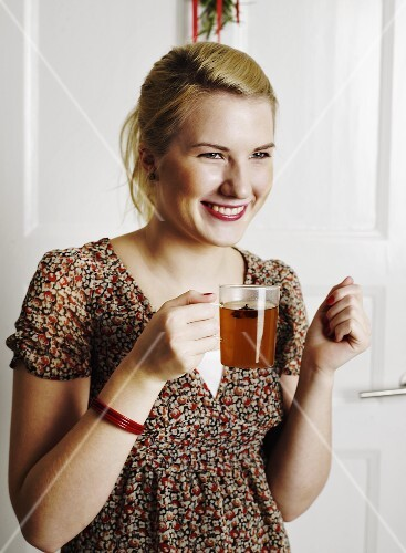 Young woman with a glass of punch