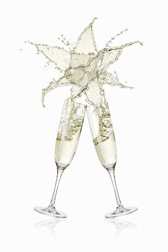 Clinking glasses of sparkling wine (with star-shaped splash)