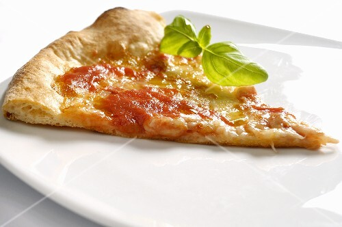A slice of pizza with basil