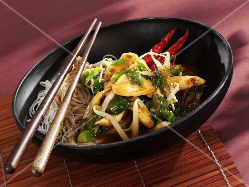 Chicken and noodles in wok