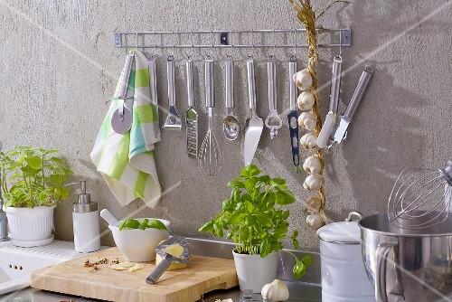 Kitchen utensils, string of garlic, basil, Parmesan etc.