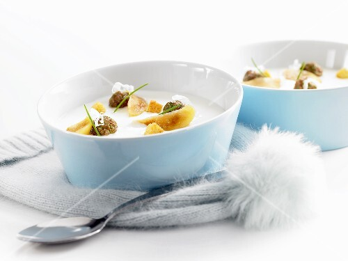 Cream of horseradish soup with minced beef balls and apple slices