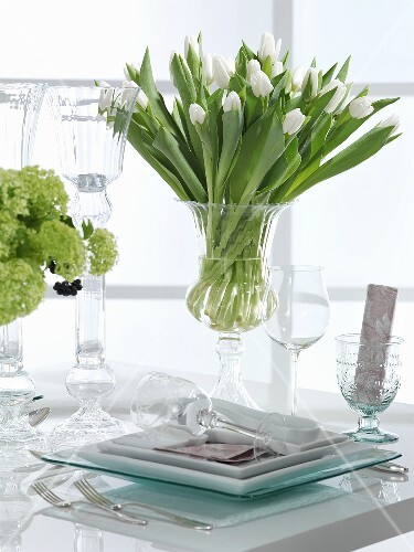 A festively laid table with white tulips