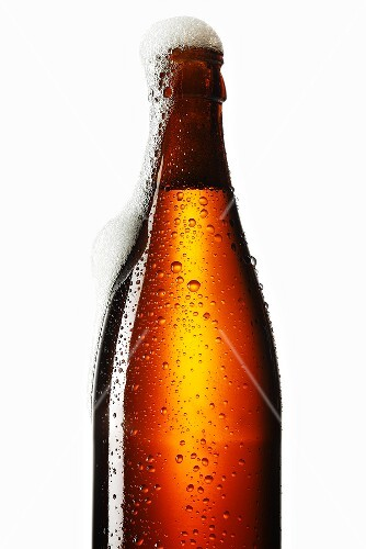 Beer frothing out of bottle