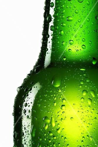 Green bottle of beer with drops of water (close-up)