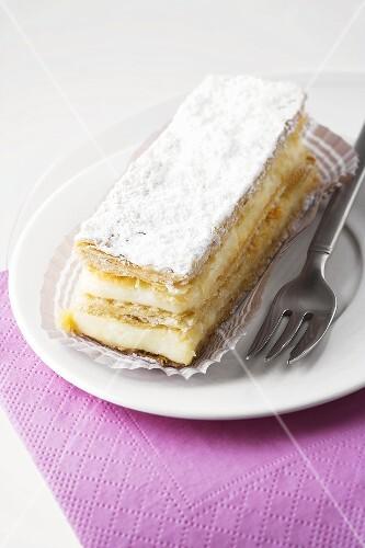 Custard slice with icing sugar