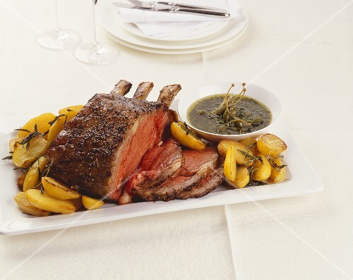 Fore rib of beef with roast potatoes and caper sauce