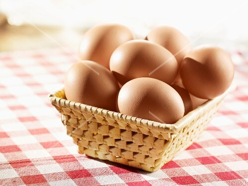 Brown eggs in a small basket
