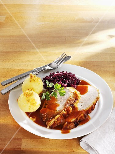 Roast pork with red cabbage and potato dumplings
