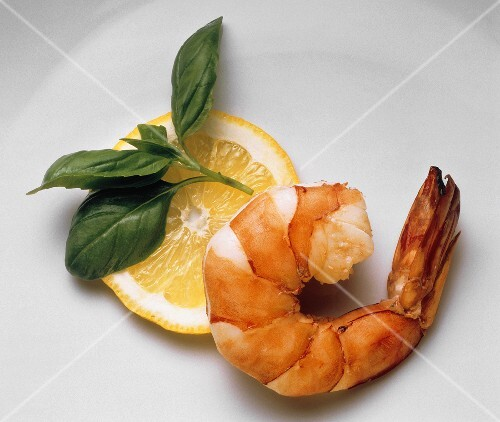 One Cooked Shrimp with Lemon Slice and Basil