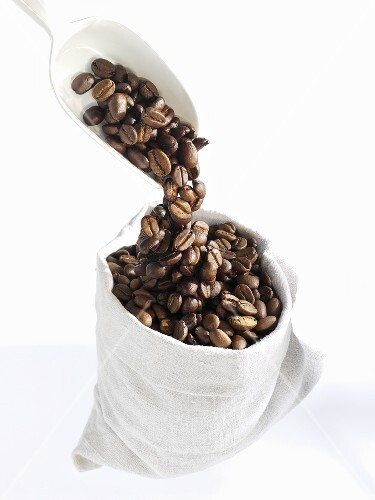 Pouring coffee beans into a bag