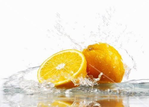 Oranges with splashing water