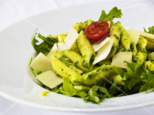 Penne with pesto, rocket and Parmesan (close-up)