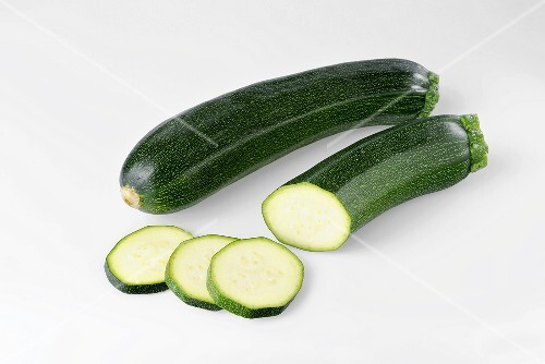 Courgettes, whole and partly sliced