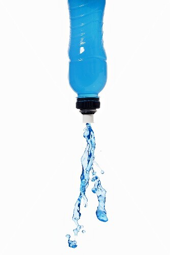 Blue energy drink squirting out of bottle