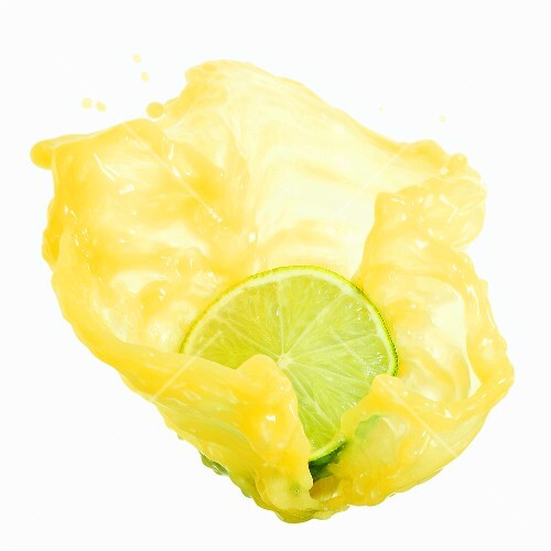 Half a lime with splashing lime juice