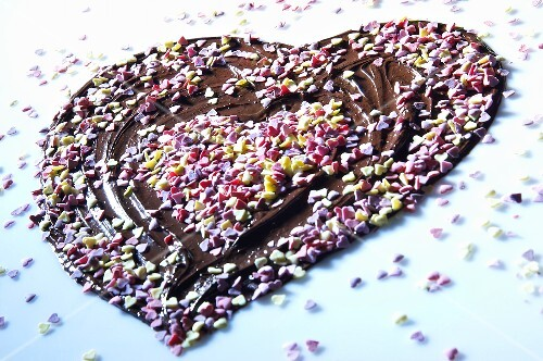 Chocolate heart with sugar hearts