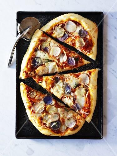 Potato pizza, cut into pieces (overhead view)