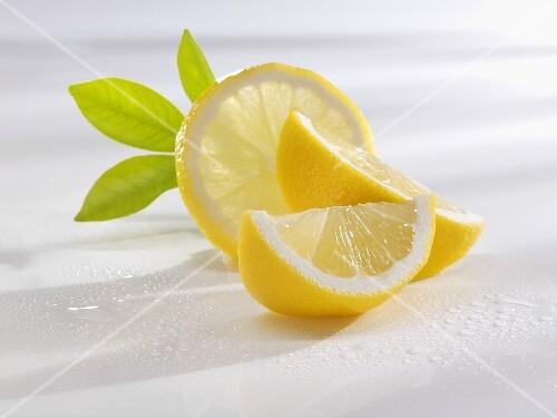 Slice of lemon and lemon wedges