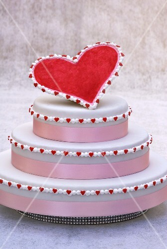Three-tiered cake with red heart