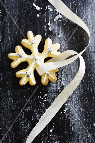 Christmas biscuit with silver dragees and ribbon