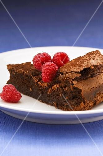 Piece of (flourless) chocolate cake with raspberries