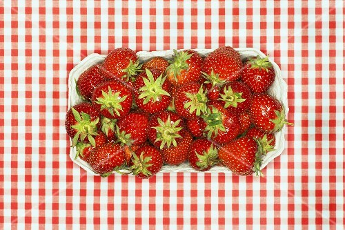 Fresh strawberries in cardboard punnet