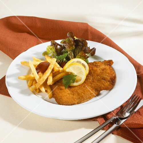 Wiener Schnitzel with chips, ketchup and … – License Images