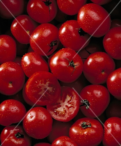 Tomatoes with drops of water (filling the picture)