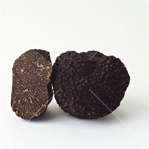 Whole and half black truffle from Perigord