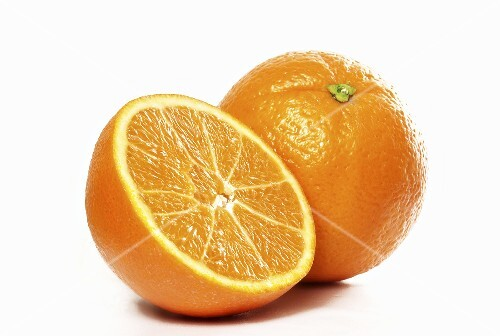 Half an orange in front of whole orange