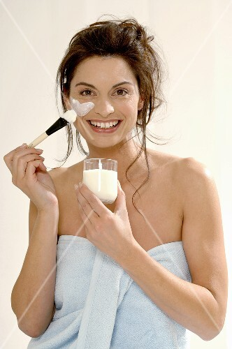 Woman applying yoghurt mask