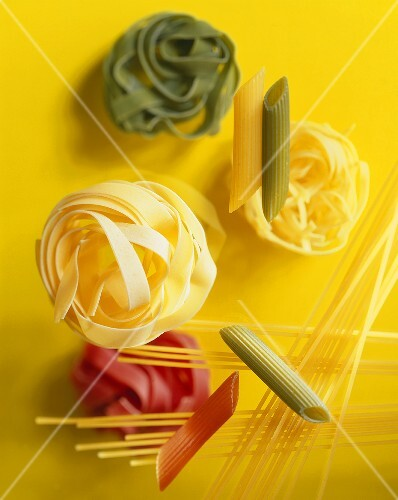 Various types of pasta on a yellow background