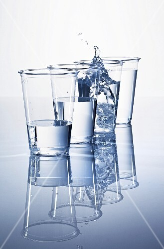 Plastic cups of water