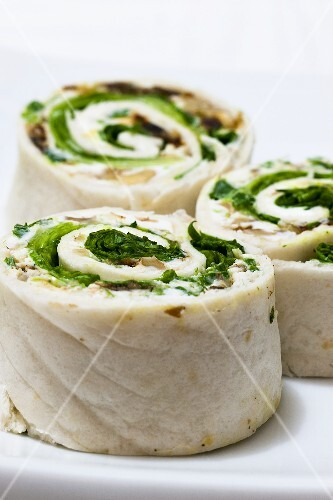 Tortilla rolls filled with goats' cheese and salad