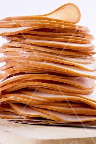 A stack of sliced ham