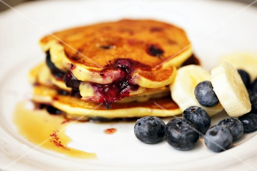 Pancakes with blueberreies, bananas and maple syrup