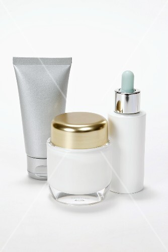 A cosmetic pot, tube and a dropping bottle