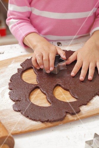 Girl cutting out biscuits