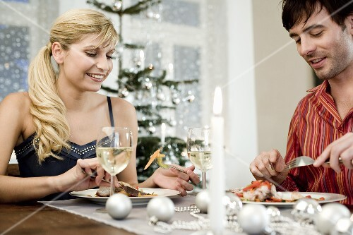 Young couple at Christmas meal