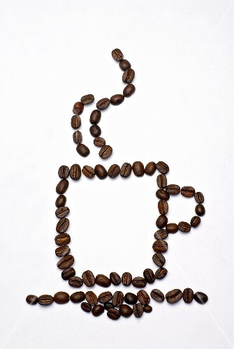 Outline of a cup of coffee in coffee beans