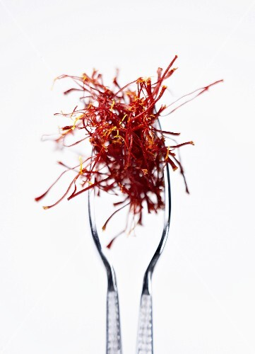 Saffron threads in tongs
